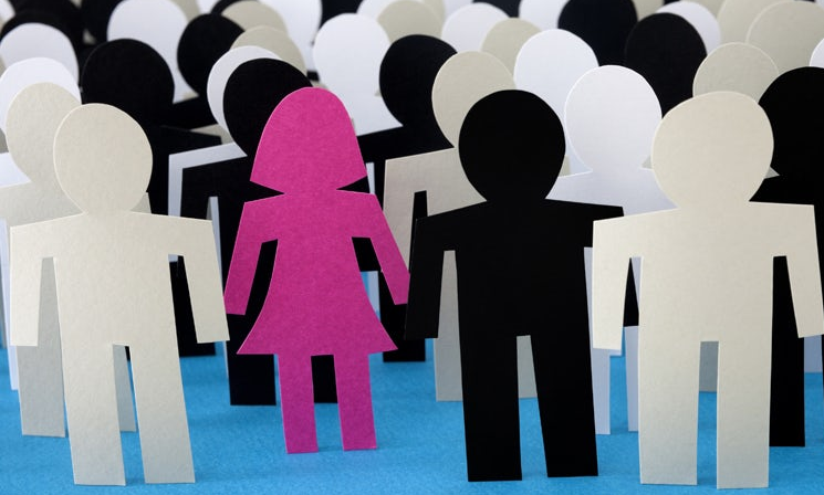 paper cutouts of people with one female cutout