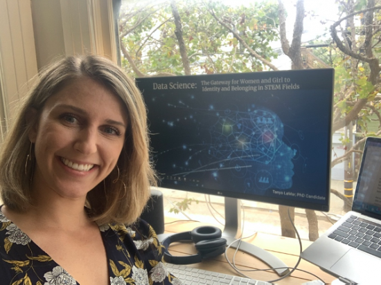 photo of Tanya in front of computer screen