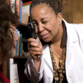 black female doctor looking at white patient