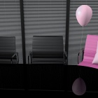 photo of two black office chairs and one pink chair with pink balloon