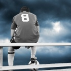 photo of player sitting alone on bleachers