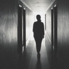 photo of woman in hallway