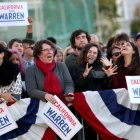 photo of women with Warren signs