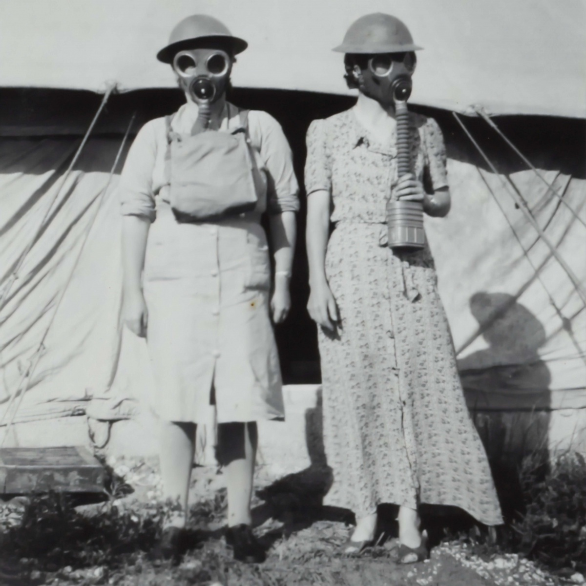 black and white photo of women with gas masks